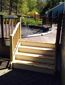Railing added to steps from deck