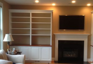 Built in shelves by fireplace